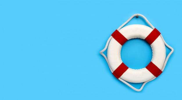 Lifebuoy on blue background. copy space