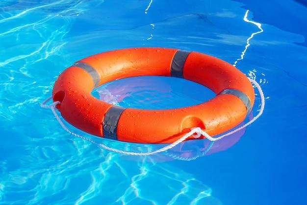Lifebuoy pool ring float. life ring in swimming pool.