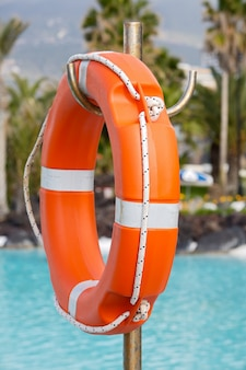 Lifebuoy in a pretty swimming pool with the blue water