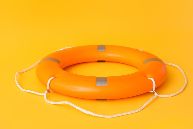 Lifebuoy ring on color surface