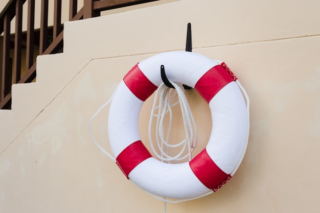 Lifebuoy on white wall