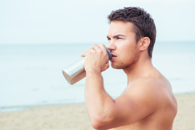 Lifeguard on the beach drinking water