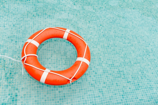 Lifeguard floating in swimming pool