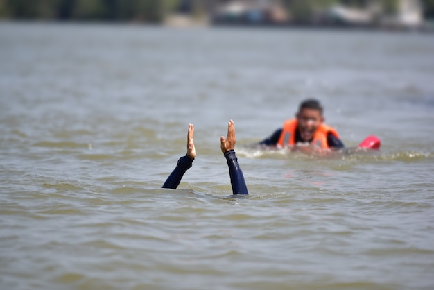 Lifeguard helps victim from drowning in river