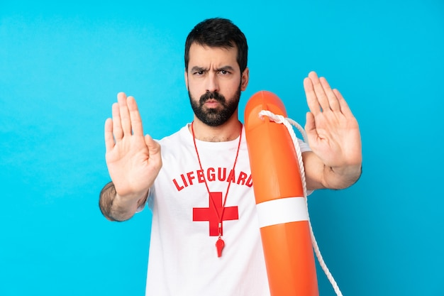 Lifeguard man making stop gesture and disappointed