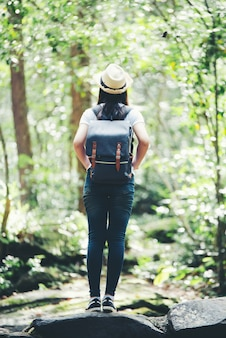Lifestyle beautiful woman happy torist to travel in wild trip hiking during vacation.