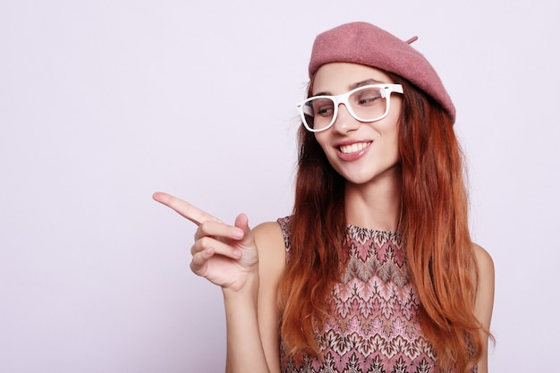 Lifestyle, beauty and people concept: beauty redhair girl  wearing pink beret