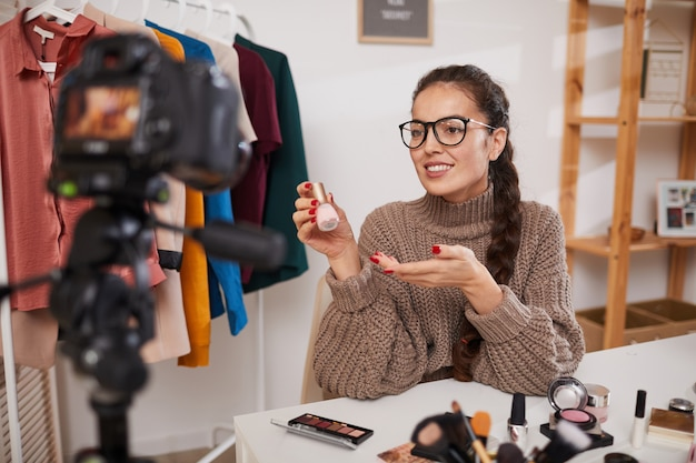 Lifestyle blogger filming video on beauty and make up