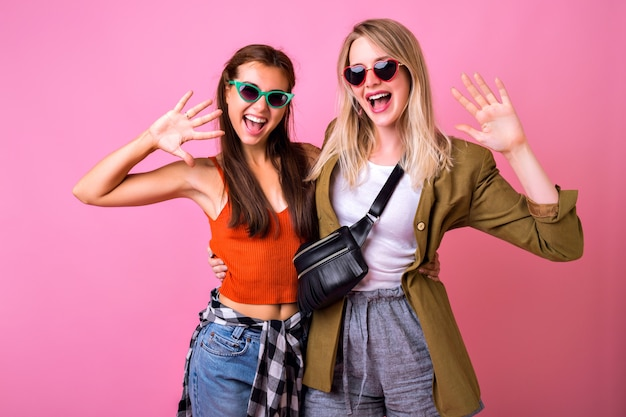 Lifestyle cheerful portrait or two stylish woman posing together