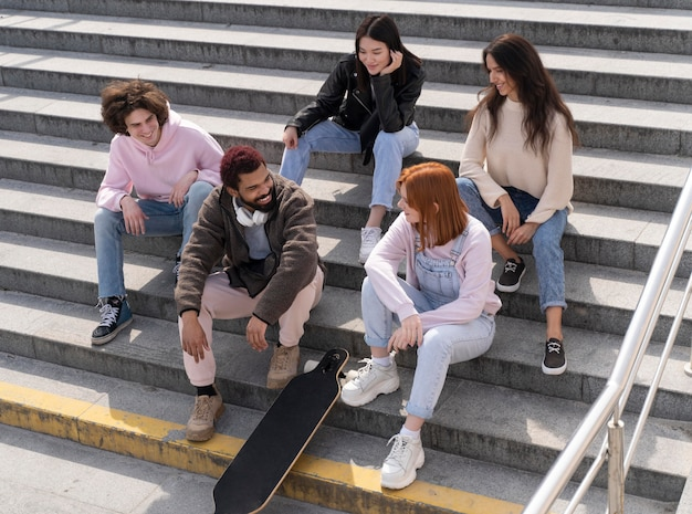 Lifestyle in city with friends on stairs