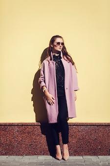 Lifestyle fashion portrait of young stylish woman