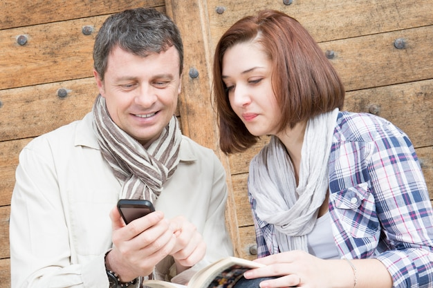 Lifestyle modern couple with app smartphone and travel guide organize vacations day in city