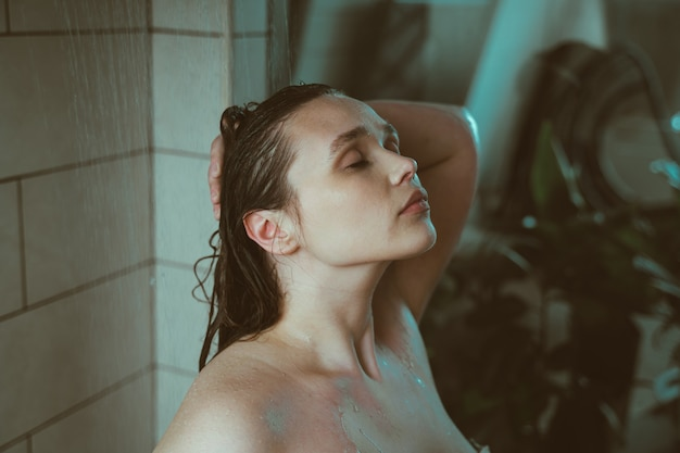 Lifestyle moments of a young woman at home woman taking a shower in the morning