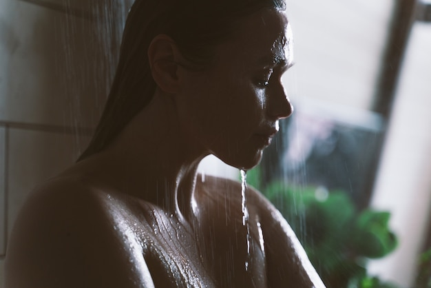 Lifestyle moments of a young woman at home. woman taking a shower in the morning