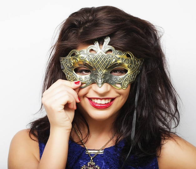 Lifestyle and people concept: beautiful brunette woman with mask. white background.