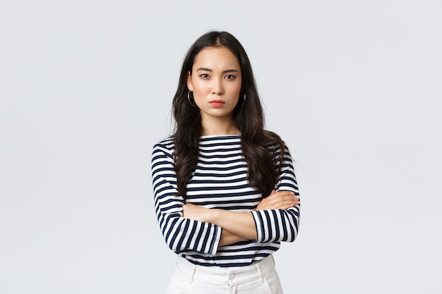 Lifestyle, people emotions and casual concept. angry disappointed woman cant forgive betrayal, cross hands over chest and looking dismay and dislike camera, standing upset