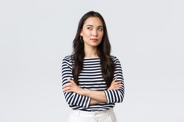 Lifestyle, people emotions and casual concept. confident nice smiling asian woman cross arms chest confident, ready to help, listening to coworkers, taking part conversation