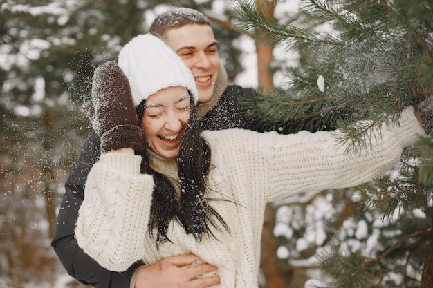 Lifestyle shot of couple walking in snowy forest