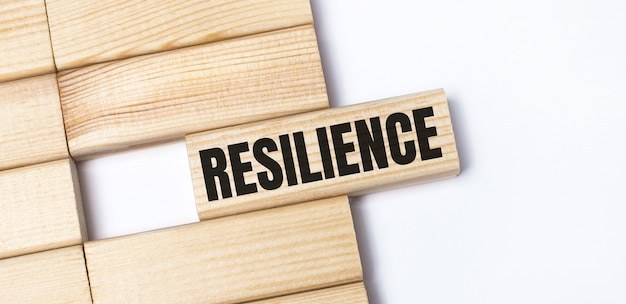 On a light background, wooden blocks with the text resilience. close-up top view.