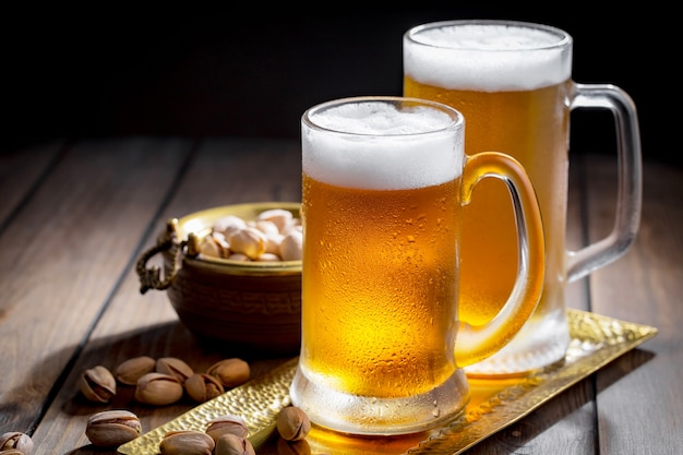 Light beer in a beer glass on an old background.