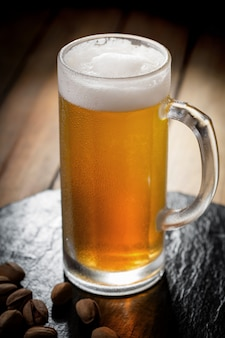 Light beer in a glass on the table