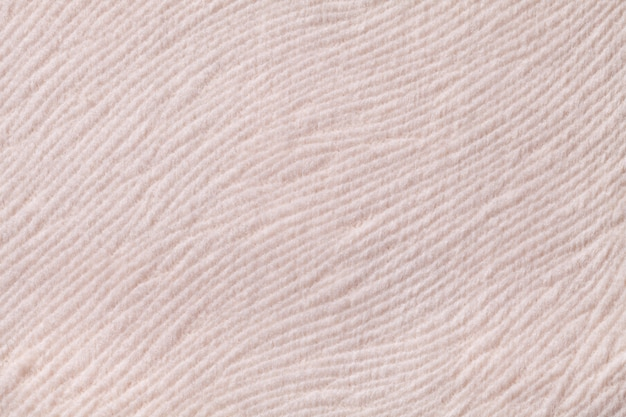 Light beige background from soft textile material. fabric with natural texture.