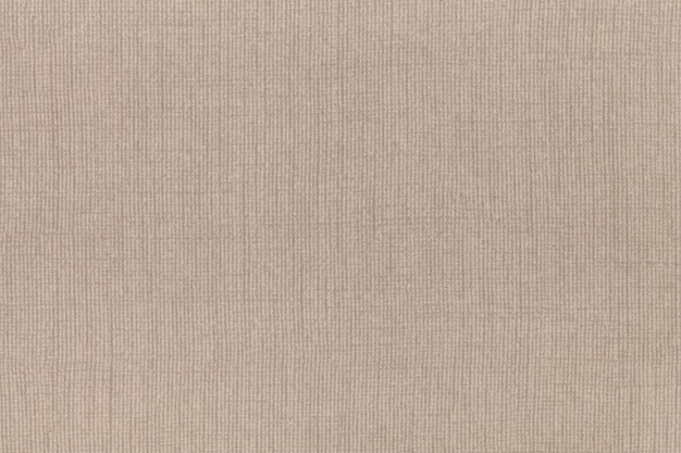 Light beige background from textile material. fabric with natural texture.