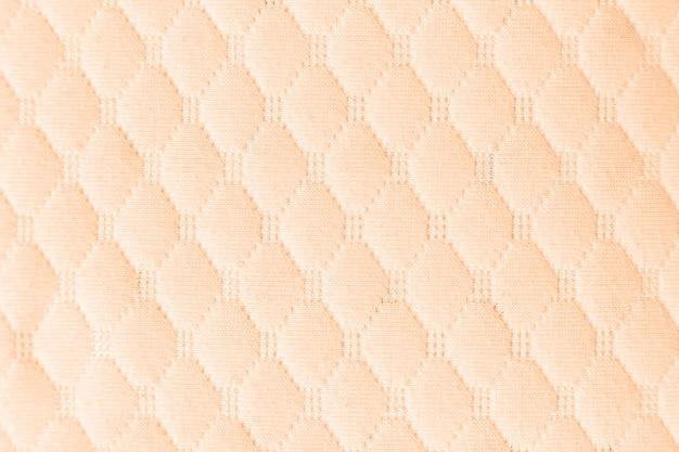 ライトベージュの織り目加工の生地の布の背景