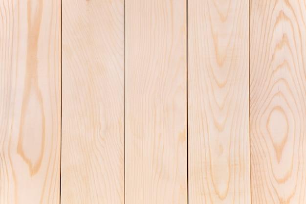 나무 수직 보드에서 밝은 빈 배경 텍스처