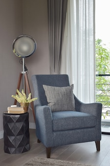 Light blue armchair with gray pillow
