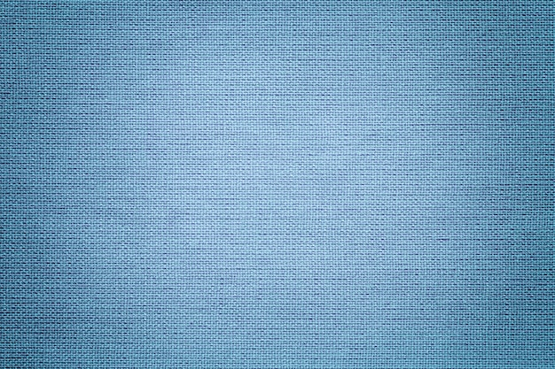 Light blue background from a textile material. fabric with natural texture. backdrop.