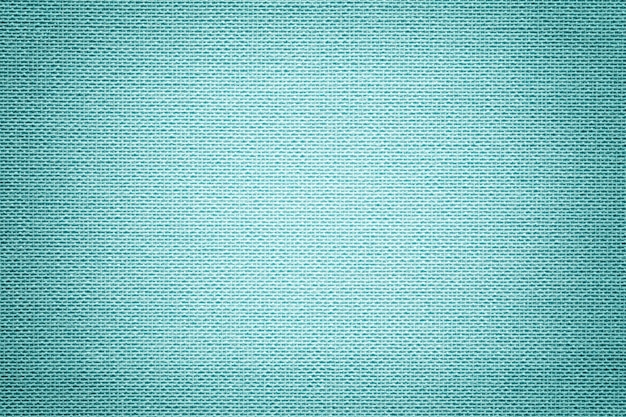 Light blue background from a textile material. fabric with natural texture