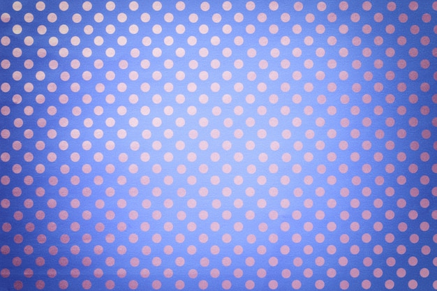 Light blue background from wrapping paper with a pattern of silver polka dot closeup.
