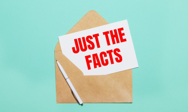 On a light blue background lies an open craft envelope, a white pen and a white sheet of paper with the text just the facts