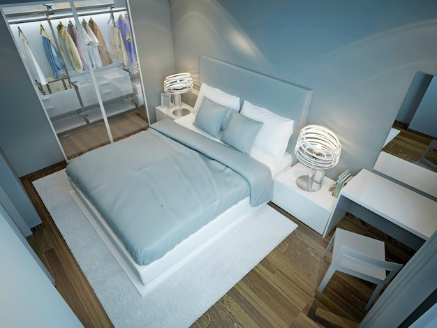 Light blue bedroom with wardrobe and dressed bed with blue and white pillows