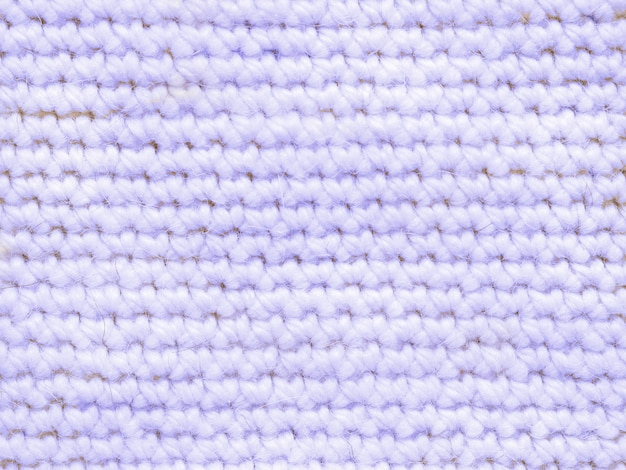 Light blue coloured knitted jersey as textile background