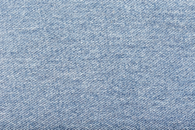 Light blue denim fabric background.