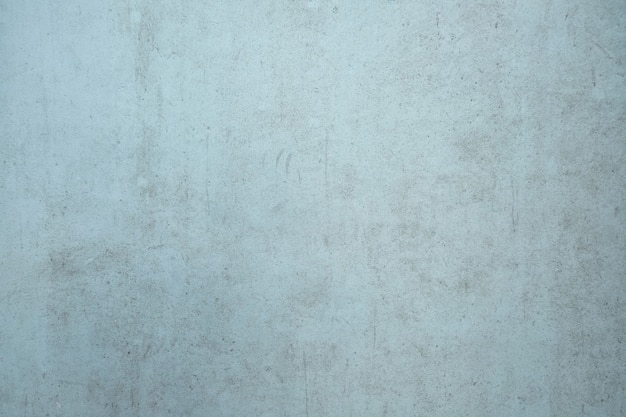 Light blue dirty cement wall background.
