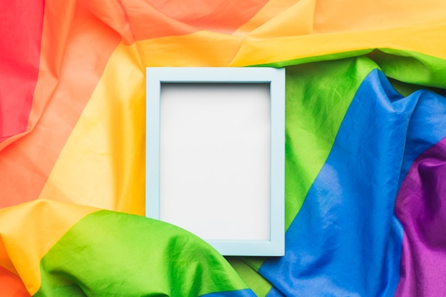 Light blue empty frame on crumpled lgbt flag