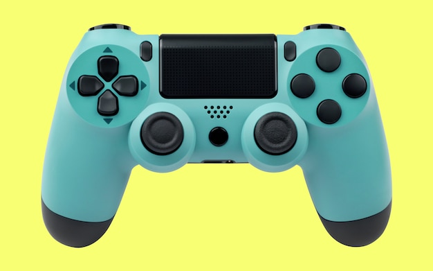 Light blue gaming controller on yellow background
