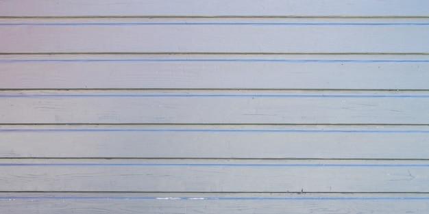 ライトブルーグレーの木製の壁の背景木板の質感の垂直