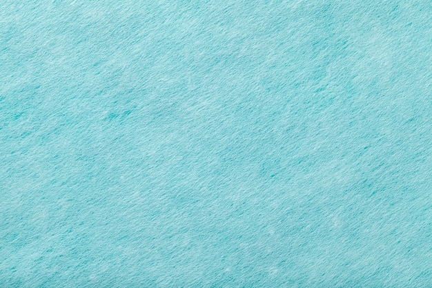 Light blue matt suede fabric closeup. velvet texture of felt.