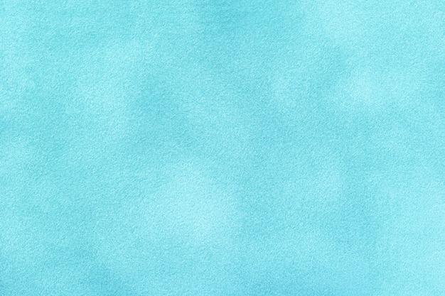 Голубой матовый фон из замшевой ткани. бархатная текстура джинсовой фетровой ткани, макро.