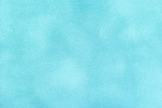 Light blue matte background of suede fabric. velvet texture of seamless denim felt textile, macro.