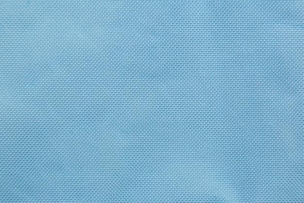 水色のナイロン生地の布のテクスチャの背景