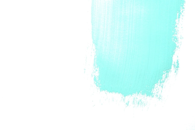 Pennellata di vernice azzurra su bianco