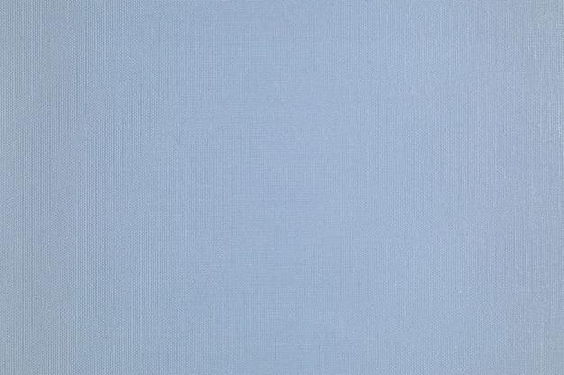 繊細なグリッドパターンと水色の紙のテクスチャの背景。
