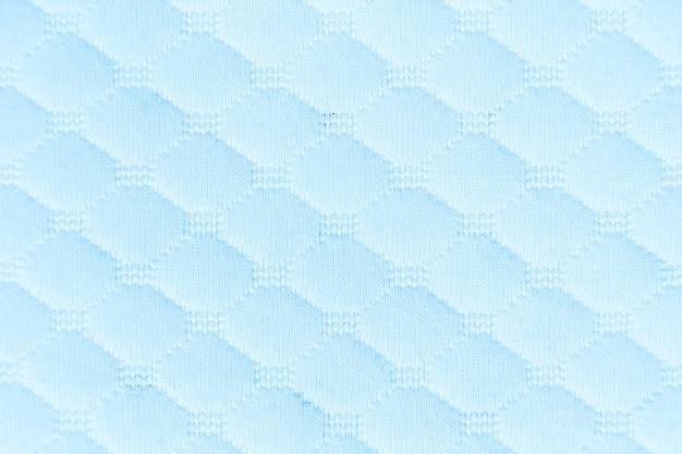 水色の織り目加工の生地の布の背景