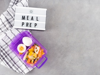 Light board with Meal prep inscription near food in container