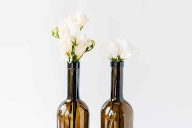Light bouquet in bottles.minimal composition of beautiful white flowers.copy space.white background.